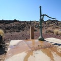 The only water available at the camp at a pump.- Fossil Falls Campground