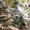Carved steps lead from the resort ruins to the waterfall.- Rising Sun Trail