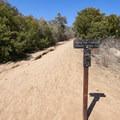 A distance marker along the trail.- Rising Sun Trail
