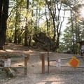 The Indian Rock Trailhead at Sanborn-Skyline County Park; the crag is 0.25 miles straight ahead.- Indian Rock