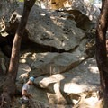 A climber prepares gear at the base of Vicious Circles (5.10d), left, and Blowing Bubbles (5.9), right.- Indian Rock