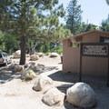 Trailhead and vault toilet facility at Splinters Cabin.- Aztec Falls Swimming Hole