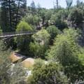 Pacific Crest Trail footbridge en route to Aztec Falls.- Aztec Falls Swimming Hole