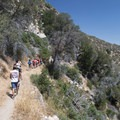 Hikers on the Pacific Crest Trail en route to Aztec Falls.- Aztec Falls Swimming Hole