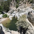 Aztec Falls swimming hole. View from the pool's 40-foot cliff jumping spot.- Aztec Falls Swimming Hole