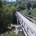 Pacific Crest Trail pedestrian bridge crossing along the route to Devils Hole.- Upper Deep Creek Canyon to Devils Hole