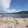 View southeast to Big Bear Lake from the West Shore Beach.- Big Bear Lake West Shore Beach