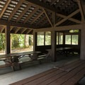 Site A picnic shelter at Honeymoon Bay Group Campground.- Honeymoon Bay Group Campground