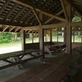 Site B picnic shelter at Honeymoon Bay Group Campground.- Honeymoon Bay Group Campground