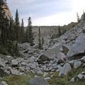 The trail traverses a large boulder field.- Black Canyon Lake