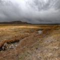 A hot creek flows southward from the Punchbowl's interior before wrapping around it.- Diana's Punchbowl/Devil's Cauldron