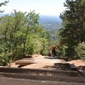 Shade on the way up the trail offers a needed reprieve from the summer sun.- The Manitou Springs Incline