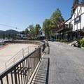 Lake Arrowhead Village promenade. Note the orange fence on the beach prohibiting swimming.- Lake Arrowhead