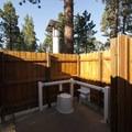 Open-air vault toilet at Bluff Mesa Group Camp.- Bluff Mesa Group Camp