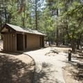 Vault toilet facilities at Pineknot Campground.- Pineknot Campground