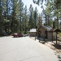 Entrance and vault toilet facilities at Hanna Flat Campground.- Hanna Flat Campground