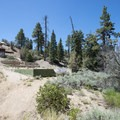 Old prospect foundation and remains just east of the Cougar Crest Trail.- Cougar Crest Trail