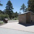 Vault toilet facility and picnic area at the trailhead for the Cougar Crest Trail.- Cougar Crest Trail