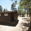 Vault toilet facility at Lobo Group Camp.- Lobo - Oso Group Camps