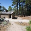 Vault toilet facility at Jenks Lake.- Jenks Lake