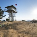 Morton Peak Fire Lookout Tower at the summit of Morton Peak (4,624 ft).- Morton Peak Fire Lookout Tower