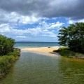 The ocean is just a stone's throw from the boardwalk.- Keālia Pond National Wildlife Refuge