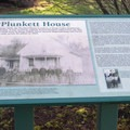 Interpretive sign in front of the Plunkett house.- Beazell Memorial Forest