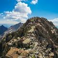 Summiting El Diente from the North Buttress route.- El Diente to Mount Wilson Traverse