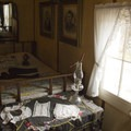 The bedroom in the Holzwarth cabin.- Holzwarth Historic Site