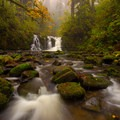 Crystal Falls below Majestic Falls clad in fall colors.- McDowell Creek Falls County Park