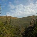 As you work your way up the rocks of Tuckerman's Ravine Trail, Mount Washington's neighbor, Mount Monroe, provides some motivation.- Mount Washington: Lion Head Trail Summer Route