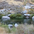 The rock formations on the left hide the hot spring.- Pyramid Hot Spring