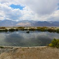 The pool is in a picturesque area at the southern end of Owens Dry Lake.- Dirty Socks Hot Spring
