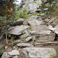 As the trail ascends to the falls, watch your step as you ascend this rudimentary granite staircase.- Bridal Veil Falls via Cow Creek Trail