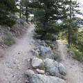 Steep switchbacks characterize the first quarter-mile.- Ypsilon Lake