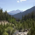 The washed out canyon at Roaring River with Long's Peak in the distance.- Ypsilon Lake