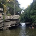 View of the falls and cliffs where people cliff jump.- Bristol (Bartlett) Falls + Circle Current Swimming Hole
