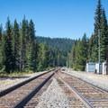 The trailhead lies across the train tracks near the parking area.- Yoran Lake Trail