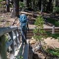 Crossing the footbridge on the way to the Yoran Lake Trail junction.- Yoran Lake Trail