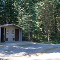 Vault toilets are spaced throughout Trapper Creek Campground.- Trapper Creek Campground