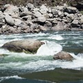 A raft pinned against a rock in Snow Hole rapids on the Lower Salmon River.- Lower Main Salmon River: Pine Bar to Heller Bar