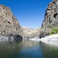 Sandy beaches and steep canyon walls along the Lower Salmon River.- Lower Main Salmon River: Pine Bar to Heller Bar