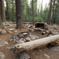 Each site has a bear locker, a table, and a fire pit.- Luther Campground