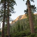 The last rays of daylight illuminate nearby peaks.- Luther Campground