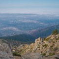 Dense urban growth below.- Cucamonga Peak