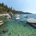 The sandy bottom of this cove shows off the beautiful waters of Lake Tahoe.- Bonsai Rock