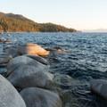Lake Tahoe's waters lap against the boulders.- Bonsai Rock