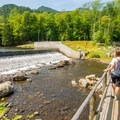 The bridge and dam just below Lower Ausable Lake.- Rainbow Falls on the Adirondack Mountain Reserve