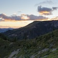 The sun sets behind nearby Coffin Mountain.- Bachelor Mountain
