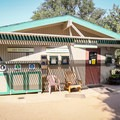 A small visitor center with limited hours but posted information near the entrance.- Fullerton Arboretum